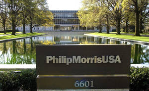 "Photo - FILE - In this November 2003 file photo is the reflecting pool in front of the Philip Morris USA headquarters in Richmond, Va. An Illinois appellate court on Tuesday, April 29, 2014 reinstated a decade-old $10.1 billion verdict in a class-action lawsuit against Phillip Morris USA that found the nation's biggest cigarette maker misled customers about ""light"" and ""low tar"" designations. Philip Morris swiftly decried Tuesday's ruling by a three-judge panel of the Mount Vernon-based 5th District Appellate Court, saying it would ask the Illinois Supreme Court to review the matter.  (AP Photo/ Richmond Times-Dispatch, P. Kevin Morley)"