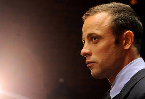 photo - FILE - In this photo taken Friday, Feb. 22, 2013 Olympic athlete, Oscar Pistorius, in court in Pretoria, South Africa, for his bail hearing charged with the shooting death of his girlfriend, Reeva Steenkamp. Even if Pistorius is acquitted of murder, firearms and legal experts in South Africa believe that, by his own account, the star violated basic gun-handling regulations by shooting into a closed door without knowing who was behind it, exposing himself to the lesser but still serious charge of culpable homicide. (AP Photo/Themba Hadebe, File)