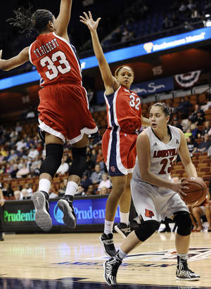 Photo - Louisville's Shoni Schimmel, right, looks to pass as Houston's Tyler Gilbert, top left, and Te'onna Campbell defend during the first half of an NCAA college basketball game in the quarterfinals of the American Athletic Conference women's tournament, Saturday, March 8, 2014, in Uncasville, Conn. (AP Photo/Jessica Hill)