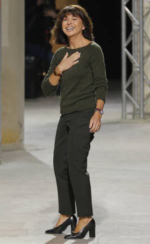 Photo - French fashion designer Veronique Nichanian reacts at the end of her Men's fall-winter 2013-2014 fashion collection presented in Paris, Saturday Jan. 19, 2013. (AP Photo/Jacques Brinon)