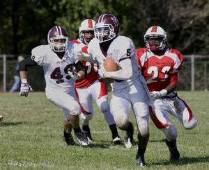 Photo - SATURDAY, OCT. 10, 2009 - Desmet's Durron Neal (5) runs for a touchdown in the third quarter during a football game between Desmet High School and Hazelwood West High School at Hazelwood West.  ©Photo by Jerry Naunheim Jr. <strong>Jerry Naunheim Jr. - Special to the Post-Dispatch</strong>
