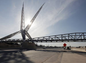Photo - The Skydance pedestrian bridge crosses the new Interstate 40 Crosstown near downtown Oklahoma City. Photo by Nate Billings, The Oklahoman Archives