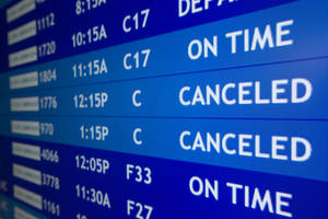 photo - Two flights to Boston are listed as canceled at Philadelphia International Airport, Friday, Feb. 8, 2013, in Philadelphia.   Airlines have already canceled more than 2,700 Friday flights as they get ready for a storm that threatens to dump up to 3 feet of snow from New York City to Boston. Flight-tracking website FlightAware shows 728 cancellations at the three big airports in the New York area. Another 191 flights to or from Boston have been scrubbed, and 137 in Toronto. (AP Photo/Matt Rourke)