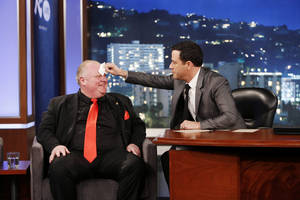 "Photo - This March 3, 2014 image released by ABC shows Toronto Mayor Rob Ford, left, having his forehead wiped by host Jimmy Kimmel on the late night talk show ""Jimmy Kimmel Live,"" in Los Angeles. Ford laughed off Jimmy Kimmel's suggestion that he get help for his drinking problem and was reported to be upset about his appearance on the late-night TV talk show.  Ford's appearance Monday night on ""Jimmy Kimmel Live"" in Los Angeles was the culmination of months of wooing by the talk-show host to get Ford to appear as a guest. (AP Photo/ABC, Randy Holmes)"