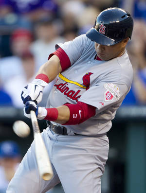 Photo -   St. Louis Cardinals' Carlos Beltran hits a two-run double off Kansas City Royals relief pitcher Vin Mazzaro during the first inning of a baseball game at Kauffman Stadium in Kansas City, Mo., Friday, June 22, 2012. (AP Photo/Orlin Wagner)