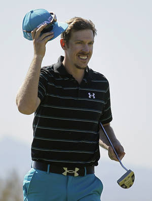 Photo -   Hunter Mahan takes off his cap upon winning his match against Steve Stricker on the 15th green during the Match Play Championship golf tournament on Friday, Feb. 24, 2012, in Marana, Ariz. (AP Photo/Eric Risberg)