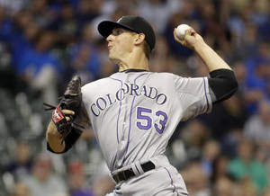 Photo - Colorado Rockies starting pitcher Christian Friedrich throws during the first inning of a baseball game against the Milwaukee Brewers Thursday, June 26, 2014, in Milwaukee. (AP Photo/Morry Gash)