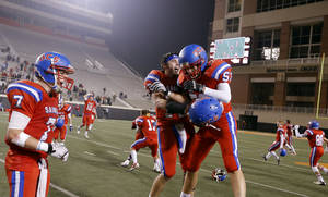 Photo - OCS celebrates following the Class 2A high school football championships between Davis and Oklahoma Christian School at Boone Pickens Stadium in Stillwater, Okla.,  Saturday,Dec. 8, 2012. Photo by Sarah Phipps, The Oklahoman
