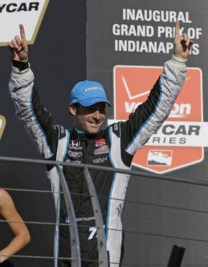 Photo - Simon Pagenaud, of France, celebrates as he walks to the podium after winning the inaugural Grand Prix of Indianapolis IndyCar auto race at the Indianapolis Motor Speedway in Indianapolis, Saturday, May 10, 2014. (AP Photo/Michael Conroy)