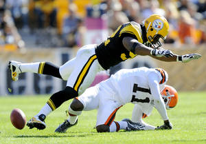photo - FILE - In this Oct. 17, 2010, file photo, Pittsburgh Steelers linebacker James Harrison (92) hits Cleveland Browns wide receiver Mohamed Massaquoi (11) during the second quarter of a an NFL football game in Pittsburgh. The Steelers released Harrison on Saturday, March 9, 2013, after the team and the hard-hitting defensive star who played on two Super Bowl champions failed to agree on a new contract.  (AP Photo/Don Wright, File)