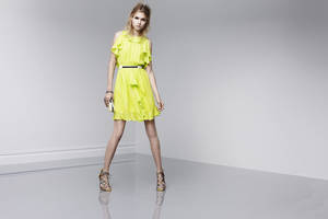 "Photo - One trick to ""dressing rich"" is to wear a ""statement"" dress, according to fashion expert Anna Johnson. Here is a bright lemon yellow ruffled dress with statement shoes from Prabal Gurung's new designer collection at Target, coming out Feb. 10. <strong></strong>"