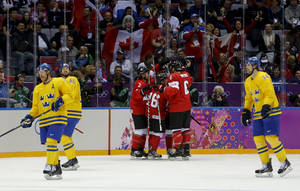Photo - Team Sweden skates back to the bench as Canada celebrates a goal during the first period of the men's gold medal ice hockey game at the 2014 Winter Olympics, Sunday, Feb. 23, 2014, in Sochi, Russia. (AP Photo/Julio Cortez)