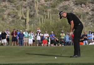 Photo - Henrik Stenson, of Sweden, putts on the 17th hole in his match against Kiradech Aphibanrat during the first round of the Match Play Championship golf tournament2 Wednesday, Feb. 19, 2014, in Marana, Ariz. Stenson won 2 and 1. (AP Photo/Ted S. Warren)