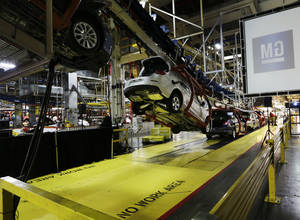 Photo - Cars move along an assembly line at the General Motors Fairfax plant in Kansas City, Kan. AP Photo <strong>Orlin Wagner</strong>