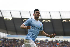 Photo - Manchester City's Sergio Aguero celebrates after scoring against Arsenal during their English Premier League soccer match at the Etihad Stadium, Manchester, England, Saturday Dec. 14, 2013. (AP Photo/Jon Super)