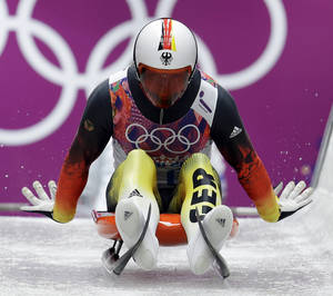 Photo - Felix Loch of Germany starts his run during the men's singles luge competition at the 2014 Winter Olympics, Saturday, Feb. 8, 2014, in Krasnaya Polyana, Russia. (AP Photo/Natacha Pisarenko)
