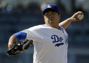Photo - Los Angeles Dodgers starting pitcher Hyun-Jin Ryu, of South Korea, throws to the Pittsburgh Pirates during first inning of a baseball in Los Angeles, Saturday, May 31, 2014. (AP Photo/Chris Carlson)