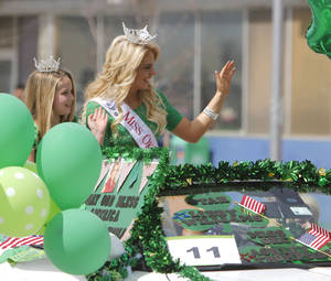 photo - Miss Oklahoma City Ashley Thompson rides in the annual Saint Patrick's Day Parade in downtown Oklahoma City, OK, Saturday, March 16, 2013,  By Paul Hellstern, The Oklahoman