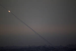 "photo -   Rockets lunched by Palestinian militants towards Israel make their way from the northern Gaza Strip, as seen from the Israel Gaza Border, southern Israel, Saturday, Nov. 17, 2012. The Israeli military says its ""Iron Dome"" rocket-defence system has shot down an incoming projectile bound for Tel Aviv. (AP Photo/Ariel Schalit)"