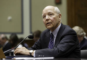Photo - Internal Revenue Service Commissioner John Koskinen testifies under subpoena before the House Oversight Committee as lawmakers continue their probe of whether tea party groups were improperly targeted for increased scrutiny by the IRS, on Capitol Hill in Washington, Monday, June 23, 2014. The IRS asserts it can't produce emails from seven officials connected to the tea party investigation because of computer crashes, including the emails from Lois Lerner, the former IRS official at the center of the investigation.   (AP Photo/J. Scott Applewhite)