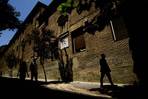 "Photo - FILE - In this July 28, 2011 file photo, pedestrians walk by the closed order convent of the Trinitarias Descalzas, where the Spanish writer Miguel de Cervantes, author of  ""El Quijojte"", was buried in Madrid, Spain. A search for Cervantes' remains will begin on Monday, April 28, 2014 at the convent where Cervantes was buried after his death in 1616. His coffin and remains were lost during construction work at the church. (AP Photo/Daniel Ochoa de Olza, File)"