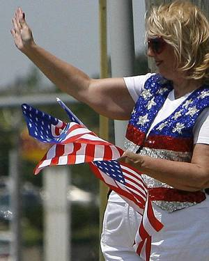 Photo - Betty Wilson and other members of the Edmond Republican Women's Club greeted Edmond drivers by waving American flags Tuesday in honor of Flag Day. Photo by Ashley R. West, The Oklahoman <strong>Ashley R. West</strong>