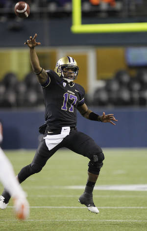 Photo -   Washington quarterback Keith Price passes in the second half of an NCAA college football game against Oregon State, Saturday, Oct. 27, 2012, in Seattle. Washington beat Oregon State 20-17. (AP Photo/Ted S. Warren)