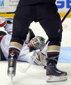 photo - Minnesota Wild goalie Niklas Backstrom stops a shot by Anaheim Ducks center Nick Bonino during the second period of an NHL hockey game, Friday, Feb. 1, 2013, in Anaheim, Calif. (AP Photo/Mark J. Terrill)