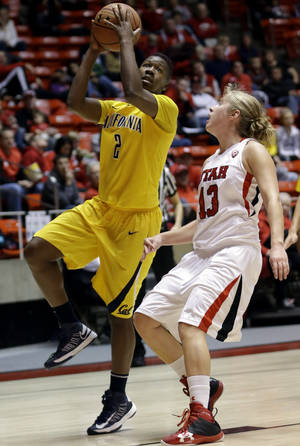 photo - California guard Afure Jemerigbe (2) lays the ball up as Utah guard Rachel Messer (13) looks on in the first half of an NCAA basketball game  onFriday, Jan. 4, 2013, in Salt Lake City.   (AP Photo/Rick Bowmer)