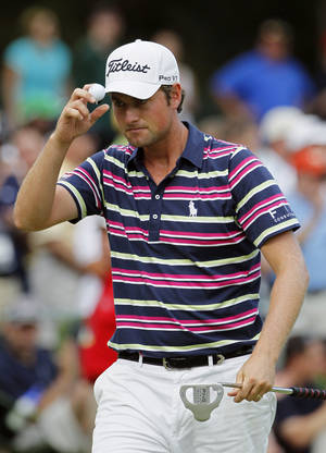 Photo -   Webb Simpson tips his hat on the 15th green during the first round of the Wells Fargo Championship golf tournament at Quail Hollow Club in Charlotte, N.C., Thursday, May 3, 2012. (AP Photo/Gerry Broome)
