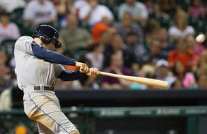 Photo - Seattle Mariners' Brad Miller drives the ball to right field for a three-run home run against the Houston Astros in the eighth inning during a baseball game Friday, July 19, 2013, in Houston. (AP Photo/Bob Levey)