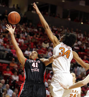 Photo - Texas Tech's Kelsi Baker (41) shoots against Texas' Imani McGee-Stafford during their NCAA college basketball game in Lubbock, Texas, Sunday, Feb. 17, 2013. (AP Photo/The Avalanche-Journal, Zach Long) ALL LOCAL TV OUT