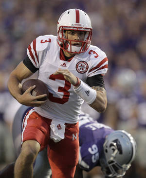 Photo - Nebraska and Taylor Martinez are leaving the Big 12 just as the program is on the rise. AP photo