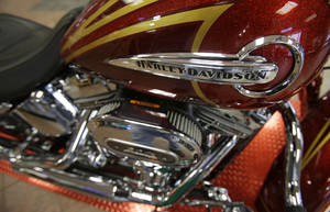 Photo - This Wednesday, March 19, 2014 photo shows CVO Deluxe Harley-Davidson at the South East Harley-Davidson in Bedford, Ohio. Harley Davidson reports quarterly earnings on Tuesday, April 22, 2014. (AP Photo/Tony Dejak)
