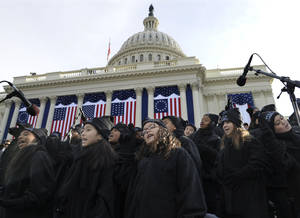 Photo - Members of the Lee University Festival Choir and PS 22 Chorus perform before the ceremonial swearing-in of President Barack Obama at the U.S. Capitol during the 57th Presidential Inauguration in Washington, Monday, Jan. 21, 2013. (AP Photo/Susan Walsh)