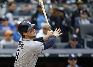 Photo - Tampa Bay Rays' Wil Myers hits a third-inning inside-the-park home run off New York Yankees starting pitcher CC Sabathia in a baseball game at Yankee Stadium in New York, Sunday, May 4, 2014. (AP Photo/Kathy Willens)