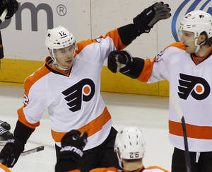 Photo - Philadelphia Flyers' Michael Raffi, left, celebrates with Luke Schenn after scoring a goal against the San Jose Sharks during the second period of an NHL hockey game, Monday, Feb. 3, 2014, in San Jose, Calif. (AP Photo/George Nikitin)