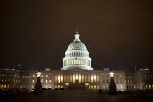 "Photo - The lights of the U.S. Capitol remain lit into the night as the House continues to work on the ""fiscal cliff"" legislation proposed by the Senate, in Washington, on Tuesday, Jan. 1, 2013. (AP Photo/Jacquelyn Martin)"
