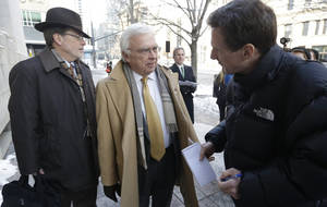 "photo - Utah Assistant Attorney General Jerrold Jensen, center, speaks with a reporter before entering the Federal court in Salt Lake City, Thursday, Jan. 17, 2013, for a hearing in the ""Sister Wives"" lawsuit challenging Utah's bigamy laws. (AP Photo/Rick Bowmer)"
