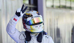 Photo - Mercedes driver Lewis Hamilton of Britain gestures after setting the pole position in the qualifying session ahead of the Spain Formula One Grand Prix at the Barcelona Catalunya racetrack in Montmelo, near Barcelona, Spain, Saturday, May 10, 2014. Lewis Hamilton earned his fourth pole position of the Formula One season Saturday as Mercedes was again in a class of its own in qualifying for the Spanish Grand Prix, while four-time champion Sebastian Vettel was left stranded by his faulty Red Bull. Hamilton clocked a leading lap of 1 minute, 25.232 seconds on the Barcelona-Catalunya circuit for his 35th career pole. (AP Photo/Manu Fernandez)