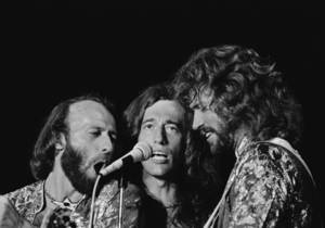 Photo -   In this Nov, 6, 1979, file photo, the Bee Gees from left, Maurice, Robin and Barry Gibb sing close into the microphone at a Miami Beach concert in Miami. November 6, 1979. A representative said on Sunday, May 20, 2012, that Robin Gibb has died. He was 62. (AP Photo/Phil Sandlin, File)