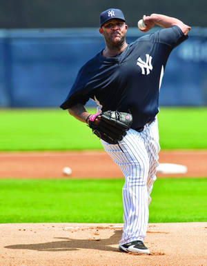 Photo - New York Yankees pitcher CC Sabathia is the current winner of the Warren Spahn Award. He also won the award in 2007 and 2008. AP photo