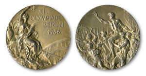 Photo - This handout provided by SCP Auctions, Inc., shows the front, left, and back, right, of one of Jesse Owens' four gold medals won at the 1936 Olympics in Berlin. SCP Auctions says the medal could go for more than $1 million when the auction opens.  (AP Photo/SCP Auctions, Inc.)