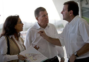 "Photo - FILE- In this March 20, 2014 file photo, Rio de Janeiro's Eduardo Paes, right, talks with Nawal El Moutawakel, head of the International Olympic Committee (IOC) Evaluation Commission, center, and International Olympic Committee (IOC) Executive Director for the Olympic Games, Gilbert Felli during a visit to the Olympic Park in Rio de Janeiro, Brazil. Earlier this month, in an unprecedented display of criticism against an Olympic host, 18 sports federations made public their widespread concerns over Rio's preparations, with some sports asking about ""Plan B"" contingencies for their venues. (AP Photo/Silvia Izquierdo, File)"