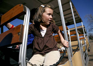 Photo - Samantha Gay, 5, of Woodward, Okla., rides the tram during her first visit to the Oklahoma City Zoo on Wednesday, Nov. 19, 2008. By John Clanton, The Oklahoman  ORG XMIT: KOD