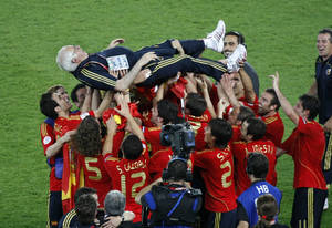 "Photo - FILE - In this June 29, 2008 file photo, Spain's head coach Luis Aragones is celebrated by his players after the Euro 2008 final between Germany and Spain in the Ernst-Happel stadium in Vienna, Austria. Former Spain coach Luis Aragones, the founder of the country's ""tiki-taka"" style of football, says he is retiring. After coaching various Spanish clubs, Aragones took over Spain's national team in 2004 and transformed it from a perennial underachiever into the 2008 European champion.  The 75-year-old Aragones, who last coached in 2009 at Turkish club Fenerbahce, tells Spanish online magazine Voxpopuli that ""age has retired me. When I left Turkey I knew it would be difficult to continue and today it is definitive.""(AP Photo/Michael Probst, File)"