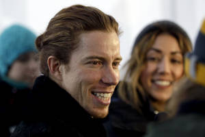 Photo - FILE - In this Dec. 14, 2012, file photo, Shaun White smiles during a television interview in Breckenridge, Colo. White on Wednesday, Feb. 5, 2014 said that he is pulling out of the Olympic slopestyle contest to focus solely on winning a third straight gold medal on the halfpipe. (AP Photo/Brennan Linsley, File)