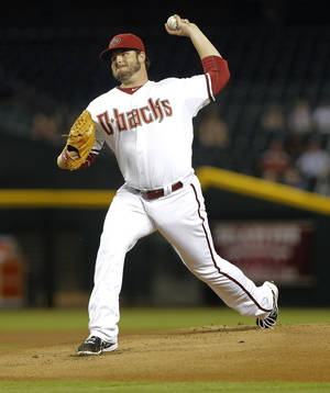 Photo - FILE - In this Aug. 27, 2013 file photo, Arizona Diamondbacks pitcher David Holmberg delivers a pitch against the San Diego Padres during the first inning of a baseball game in Phoenix. The Cincinnati Reds have acquired Holmberg from the Diamondbacks in a three-team trade. (AP Photo/Matt York, File)