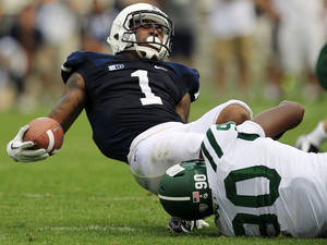 photo -   Penn State running back Bill Belton (1) is tackled by Ohio defensive lineman Tremayne Scott (90) during the third quarter of an NCAA college football game at Beaver Stadium in State College, Pa., Saturday, Sept. 1, 2012. Belton was injured on the play and left the game. Ohio won 24-14. (AP Photo/Gene J. Puskar)