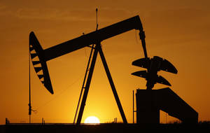Photo -   FILE - In this March 22, 2012 file photo, a pumpjack is silhouetted against the setting sun in Oklahoma City. Americans depend on energy for everything from driving their cars to powering factories, homes and offices _ and of course our smart phones, laptops and tablets. How that energy is produced and where it comes from affect jobs, the economy and the environment. (AP Photo/Sue Ogrocki, File)